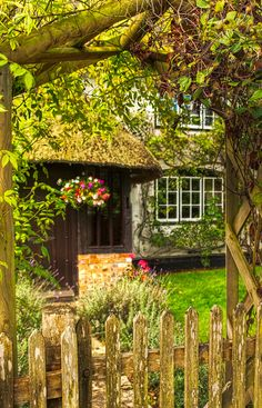 A view into a pretty cottage garden in the village of St. Mary Bourne in Hampshire | by Anguskirk