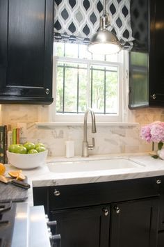Curtain for window over sink =  good idea for nice focal point, added interest and dimension.