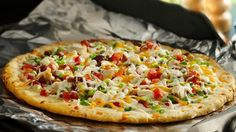 Need we say more? Bacon, chicken, cheese, veggies and ranch dressing on top of a crispy cheesy-garlic crust. Awesomely delicious!