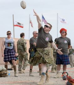 British soldiers show the Americans how it's done as they host Highland Games in Afghanistan (all washed down with haggis and Irn-Bru)