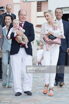 Prince Albert II of Monaco, Prince Jacques, Princess Charlene of Monaco and Princess Gabriella are welcomed by dancers wearing traditional costumes during the annual traditional 'Pique Nique Monegasque' on August 28, 2015 in Monaco, Monaco.