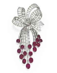 Platinum, 14 Karat White Gold, Ruby and Diamond Brooch, Van Cleef & Arpels The stylized bow suspending an articulated fringe, set with 16 oval-shaped rubies weighing approximately 12.55 carats, accented by round and baguette diamonds weighing approximately 16.50 carats, signed Van Cleef & Arpels, numbered N.Y. 23366; circa 1950.