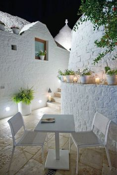 A garden patio turned into a romantic candlelit setting with plants and candles