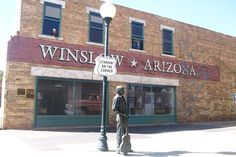 Standin on a corner in Winslow Arizona, such a fine sight to see......   (In the 2nd story window there's a couple dancing and in the window on the top left is an eagle)