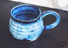 This blue mug has certainly won my heart! For those of you wondering the color combo, it's Amaco's Arctic Blue over Amaco's Obsidian. It looks even brighter in the sunlight. ☀️✨ On another note, I'm not entirely sure if you all saw this in my story or not, but I have a batch of super cute new creamer and sugar sets, some of which are currently drying on my shelves! (Eeee!!) They are adorable — and they have stripes on them like my striped mugs. So glad they were so much fun to make! Have...