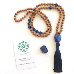 This 108 bead Mala necklace is created with Sandalwood and Lapis Lazuli beads with a Lapis Lazuli nugget guru bead. This spiritual necklace is strung on a blue thread with a blue tassel. The approximate length including the tassel is This mal Horseshoe Necklace, 14k Gold Necklace, Star Necklace, Initial Necklace, Necklace Ideas, Mala Necklace Diy, Jewelry Ideas, Jewelry Accessories, Necklace Tutorial