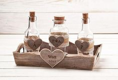 Wedding Unity Sand Ceremony Set. This ever so adorable Rustic or Country style Sand Ceremony Set is the perfect addition for your wedding ceremony. This listing comes with three Jars set and wooden tray has been stained and distressed giving it a beautiful rustic look.This set #unitycandleholders