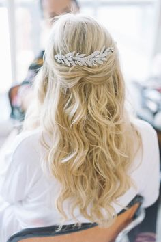 Dress up a half updo on your wedding day by adding a chic hair accessory