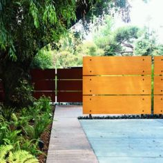 Warm contemporary screen could disguise a car or some other distraction from your landscape. Consider adding texture with a row of ornamental grasses in front to soften the look.