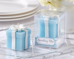 "There's no need to borrow, because everyone at the wedding will be treated to something blue when you thank them with our ""Something Blue"" Wedding Gift Candle Wedding Favors (Set of 4)!  This most meaningful candle favor puts a new take on an old and dearly loved tradition.Gift box-inspired, sky-blue candle accented with white, candle ribbon and bow.  Sold in a set of 4.Size:  Candle measures approximately 1 3/4"" h x 1 1/4"" w x 1 1/4"" d"