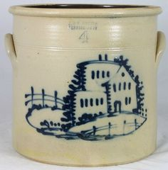 """J. & E. NORTON BENNINGTON VT 4 gallon crock.  Decorated with a rare, one of a kind rendition of a round castle style house with a flat top building and house in the front. Fences and lots of ground cover finish with great blue design.    Professional restoration to a tight clay separation or freeze line around the base on the front and under the right ear. 11 1/2"""" 1855 sold $ 5500"""