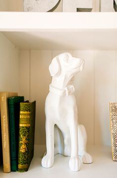 Dog statue on bookshelf