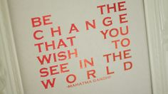 """Be the change that you wish to see in the world."" - Mahatma Gandhi. This foil print would be beautiful on the wall of a nursery. Pictured in red with a white background."