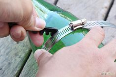 How to Make Wine Bottle Wind Chime: 17 Steps (with Pictures). Edited by Gerard Plamenco, Laura. The hose clamp looks like a good idea.