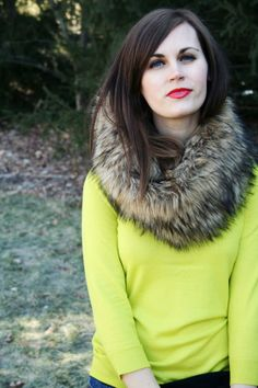 bright crewneck and dark skinnies with a fur scarf