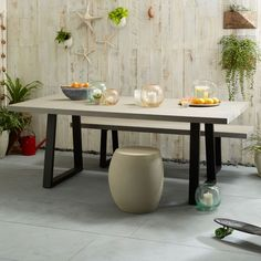 Crafted from lava stone atop an iron base, the Slab Dining Table's hand polished, versatile surface is equally at home indoors or outdoors. Its simple design and durable frame make it the perfect piece to gather 'round any time of year.