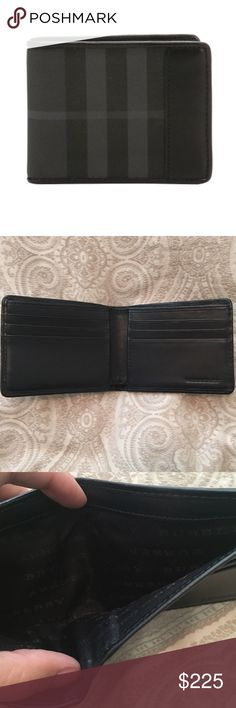 Burberry Men's Black Check Folding Wallet NEVER USED! Bought it for my boyfriend last year and has never used it! Italian-made folding wallet in black check with smooth sartorial leather trim.                                           11 x 9cm/4.3 x 3.5in 100% polyamide with leather trim Inner: 100% calf leather Lining: 100% polyamide Six card slots Note compartment Made in Italy Burberry Bags Wallets