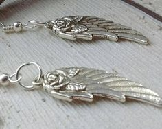 Hey, I found this really awesome Etsy listing at https://www.etsy.com/uk/listing/540233648/angel-wing-earrings-angel-wings-rose