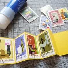 I started making miniature books around 20 years ago - many of them are small enough to fit into matchboxes. They're very easy to make - this one was made using some vintage stamps.