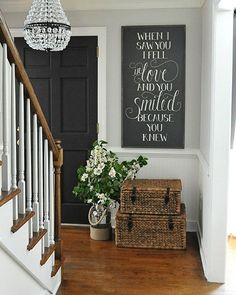 "A batch of this sign AND a batch of our ""Whatever our souls are made of..."" Emily Brontë sign will be available in our shop this morning at 10 EST. www.dearlillie.com (or click on link in profile) Wall color is Moonshine, trim is Simple White and door color is Mopboard Black all by @benjaminmoore. This is the Mia Pendant from @potterybarn. Baskets and lantern (which we are using as a vase) are both from @homegoods."