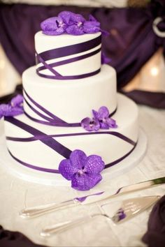 Lovely purple cake. I would remove the flowers and leave the ribbon on.