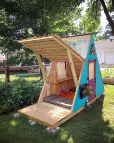 My kids' A-Frame playhouse. Designed and built by me. DIY from start to finish. East Wall opens into an awning for more open play.