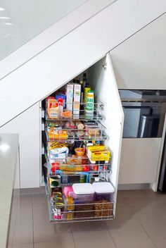 Slide Out Pantry Storage Under Stairs The space underneath a staircase is often used for storage in an unorganised way but is it maximising its potential? Storage in this under stairs . Staircase Storage, Basement Storage, Basement Stairs, Pantry Storage, Pantry Organization, Staircase Design, Kitchen Storage, Storage Spaces, Storage Ideas