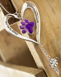 Take to the roads with a constant reminder of beloved pets who are there in spirit, watching over you. Our heartfelt car charm bears a dangling purple paw in the center with a timeless message along the edge of the heart.