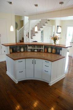 Rounded kitchen island. Love the storage underneath.