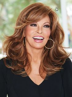 "Curve Appeal by Raquel Welch is a long, layered, and voluminous synthetic wig made with heat-friendly fiber. The sheer lace front creates the look of your own hairline, giving you the most natural appearance. The monofilament part is hand-tied and sheer mimicking natural hair growth and blending in with all skin tones. This style is glamorous and gives you that signature ""Raquel Welch"" look in seconds. Straight Updo, Popular Haircuts, Most Popular, Wigs, Curls, Hair Cuts, Hair Wigs, Roller Curls, Haircuts"