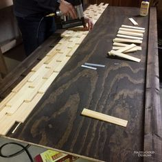 wood shim headboard - stained back adding shims