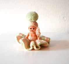 Tiny Vintage Doll with Pink Green Dress / Mini Kewpie Doll with Crochet Dress / Vintage Small Synchronized Swimmer Doll with Pink Dress This is a sweet early 1950s Kewpie doll from Europe. She is a tiny little thing, with lots of charm. She looks like those old fashioned Synchronized swimmer you see in old movies. Shes wearing a crocheted pale pink and green dress and hat, with a pom pom on top. A friend of mine from the Czech Republic said she had one as a child growing up. She measures…