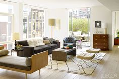 In the living room of Lisa Pomerantz and Jonathan Copplestone's Manhattan apartment, the Berber rug is vintage. Get the look: Hand Knotted Vintage Moroccan Berber Rug, $3,093.99, domino.com