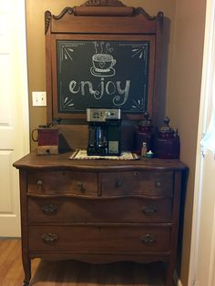 Turn an old dresser into a coffee bar! All we did was use chalkboard paint on the mirror. Easy and super cute!