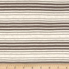 Sheer Yarn-Dyed Striped Jersey Knit Dark Taupe from @fabricdotcom  This very lightweight jersey knit fabric is perfect for creating stylish tops, tanks, and T-shirts. It has 25% stretch across the grain. It Features horizontal yarn-dyed stripes of sheer pearlized dark taupe and heather ivory.