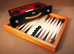 """For your gift shopping pleasure! Ship this beautiful backgammon set Free via Ground Shipping this holiday season to that special backgammon player in your life! 16"""" Chiellini Wood Attache w/Drawer! Black & red set by Chiellini of Italy, who creates this wood attache backgammon set which ideally protects your backgammon game pieces, too.  Dice and checkers included. Board measures 16.5"""" x 9' x 3"""" http://www.thegamesupply.com/backgammon-sets #freeshipping #backgammonboardgames"""