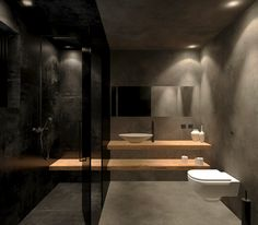bathroom / wc design, black tile and cement mortar. black glass and wooden counter