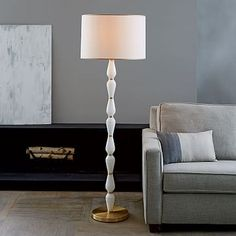 For the library area - in the corner by the windows on the front of the house - Roar + Rabbit Faceted Glass Floor Lamp – White/Antique Brass #westelm