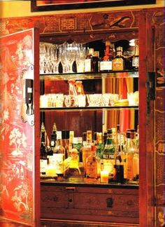 Alessandra Branca - beverage bar tucked away inside a wardrobe/chinoiserie decor