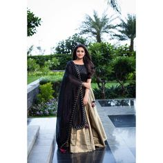 Indian actress Keerthy Suresh wears a stunning black and gold lehenga for the promotions of her upcoming tamil movie Sandaikozhi 2 . Indian Designer Outfits, Indian Outfits, Designer Dresses, Designer Lehanga, Indian Attire, Indian Clothes, Indian Wear, Half Saree Designs, Lehenga Designs