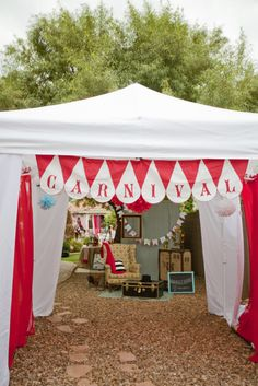 Carnival decoration idea--adapt a shade tent as an entrance or photo booth
