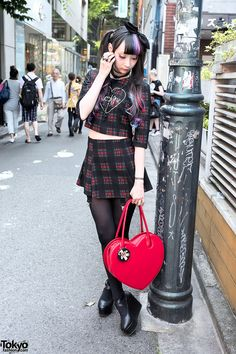 Always-sweet Tokyo-based model RinRin Doll on the street in Harajuku wearing a cute look by the brand Morph8ne.