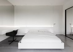All-white bedroom with nice inderiect lighting.