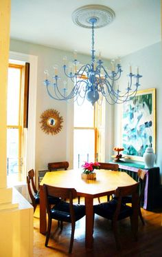 Brass Chandelier: New & Improved A coat of colorful paint brings this antique right up to the minute and gives this dining room a bright, modern look.