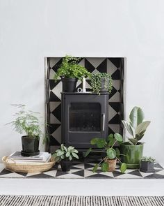 en can be equally serene and peaceful. It brings to mind bucolic pastures and meadows, escapes to the countryside, fresh air and healthy vibes. Grey's been so overdone, so how about it? Here I've gathered a bit of green inspiration for your green home: Wood Stove Hearth, Wood Burner Fireplace, Fireplace Facing, Living Room Decor Fireplace, Living Room Plants, Room With Plants, Living Room Green, Tiled Fireplace, Fireplace Mantle