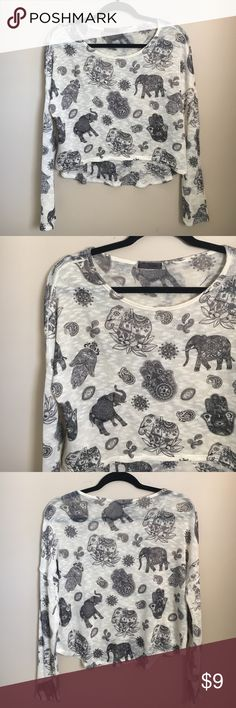 Spiritual Bohemian Elephant Fatima Hand Top Light and Loose fitted long-Sleeved Top covered in elephants, spiritual Fatima hands, and Bohemian lotus flowers and paisley patterns. Polyester/Spandex material giving it a stretchy, comfortable feel! Has somewhat of a high-low effect to it. Size- S (true to size) Length (in front)- 17 1/2 inches Length (in back)- 20 inches If you have any other questions, please don't hesitate toco tact me xoxo Joyce Leslie Tops Blouses