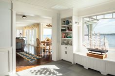 Beach Style Providence Cottage: A Built In Adds Storage Space And Frames The  Calming Ocean View In The Foyer.