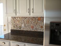 Seashell Backsplash... can't wait to do this in my own home