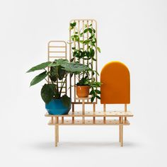 Etta acts as a place to display your plants and objects, it's a space divider, and it also offers a place to sit, perfect for putting on your shoes.