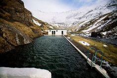 This one isn't in the guide books or on the tourist trail, but out there in the nowhere. Iceland's oldest swimming pool, built into the mountainside in a narrow valley, has been gathering hot water trickling down from Eyjafjallajökull (I can't pronounce it either) since it was constructed in 1923. T